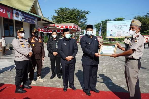 Pimpin Upacara HUT Agraria Ke-61, Bupati Alfedri Apresiasi BPN Siak