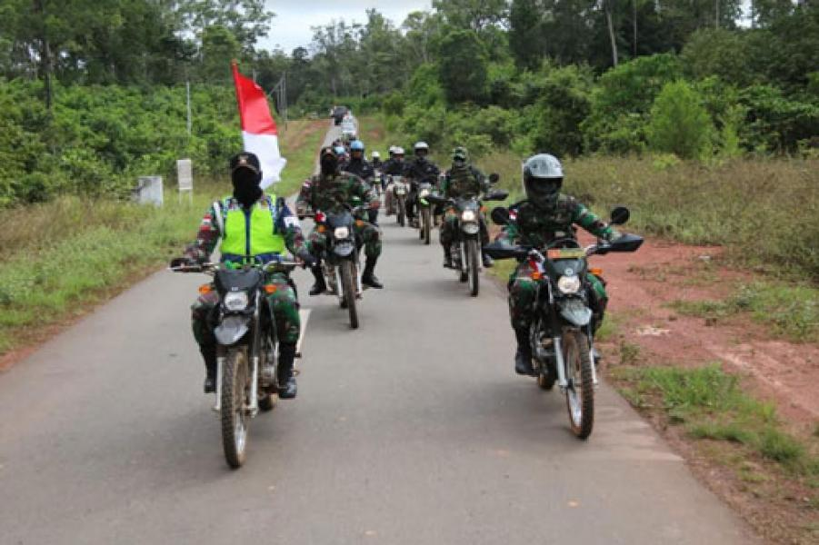 """Satgas Pamtas RI-PNG Yonif Mekanis Raider 411 Kostrad Gelar """"Touring Kemerdekaan"""""""